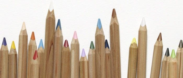 colored pencil tips on a white background