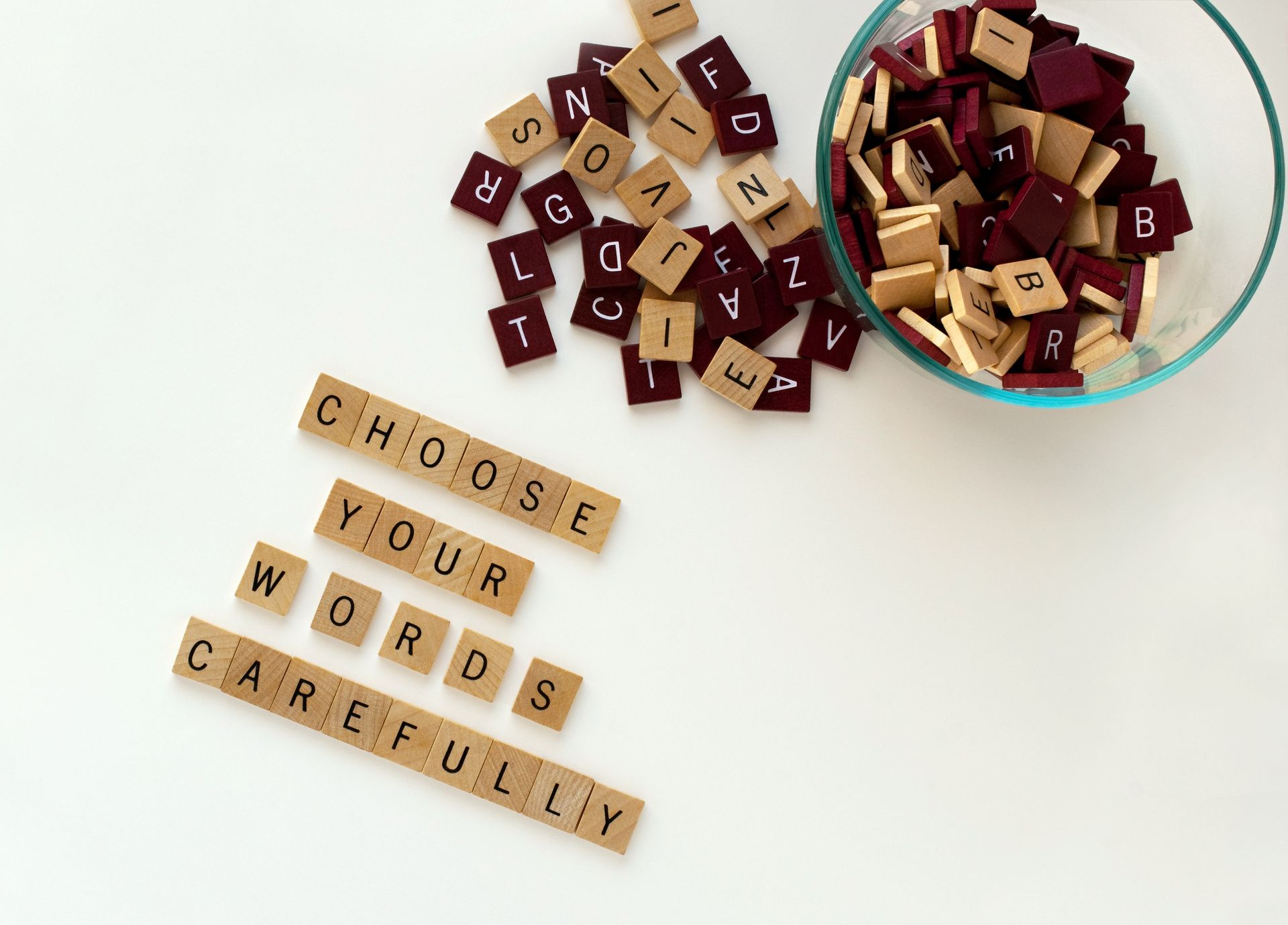 Choose Your Words Carefully spelled out in scrabble tiles
